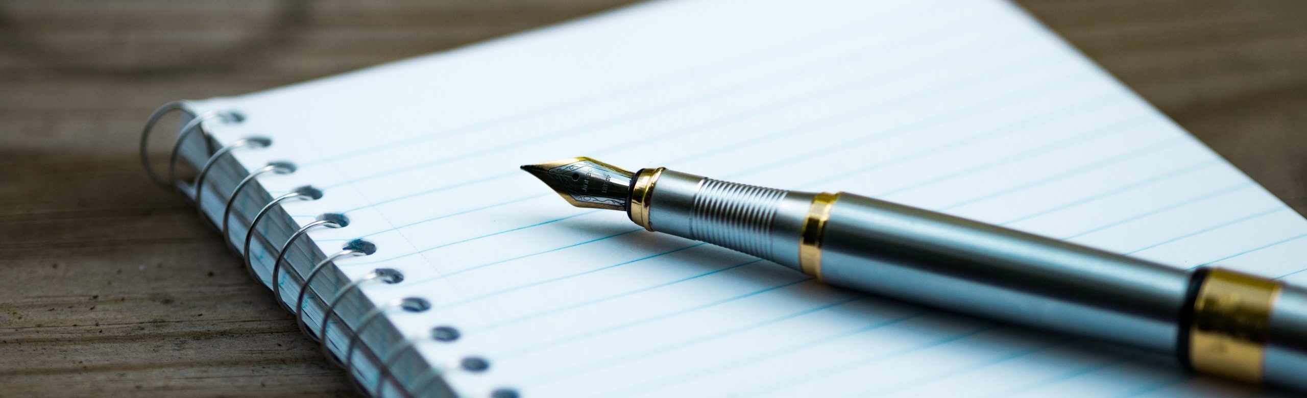 fountain pen on spiral book